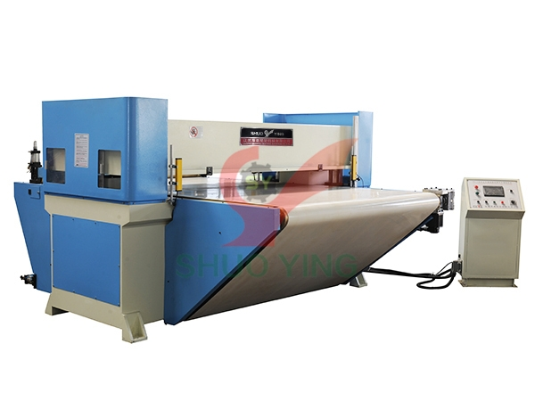 Conveyor belt cutting machine